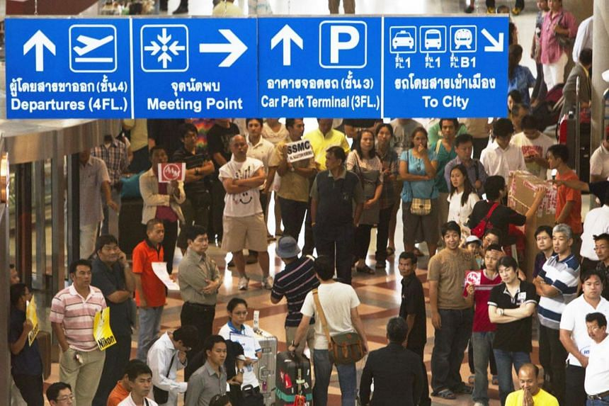 People waiting in an arrival hall at Suvarnabhumi Airport in Bangkok, Thailand.