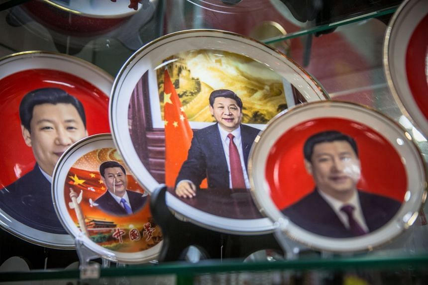 Souvenir plates featuring Xi Jinping are displayed at a souvenir shop in Beijing.