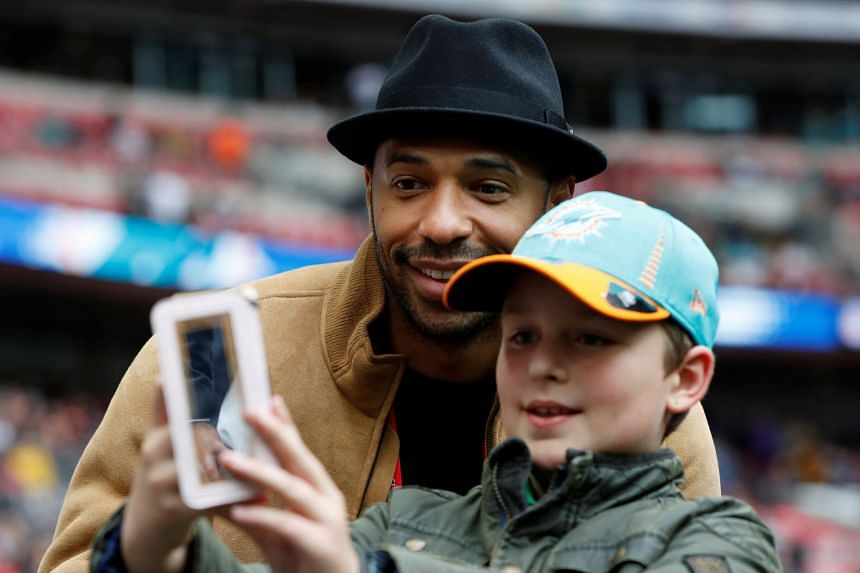 Thierry Henry taking a selfie with a young fan in October 2017.
