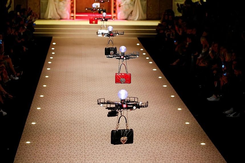 Designers to the stars Dolce & Gabbana opened the gates of fashion heaven on Sunday in a spectacular show, one of the last events of Milan Fashion Week. At the show's start, bells chimed, golden gates opened and drones flew out, carrying the brand's