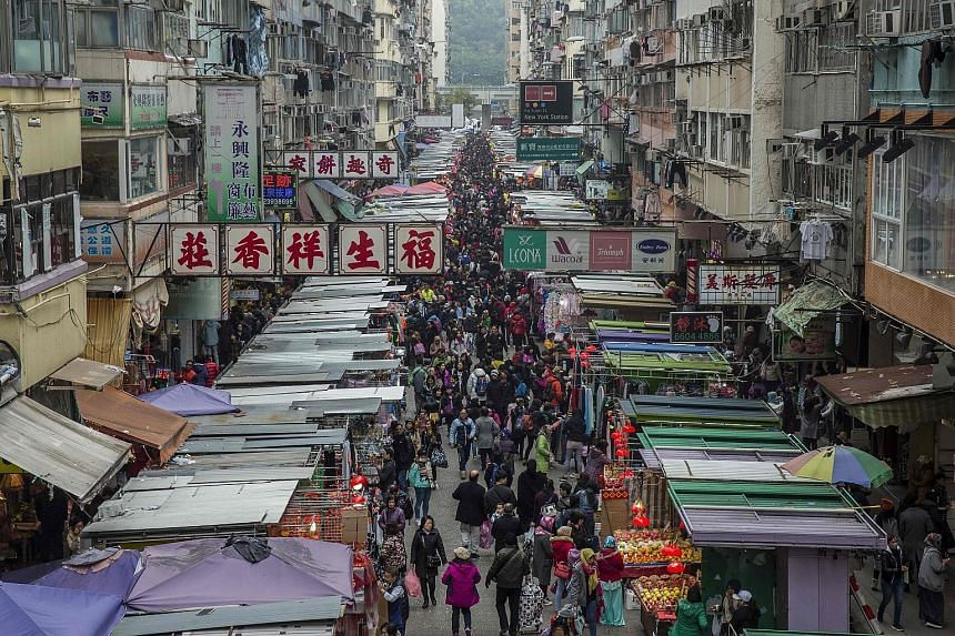 With Hong Kong (above) now comparable to New York in terms of income inequality, and amid persistent worries that its role as a financial centre is being eclipsed by the likes of Shenzhen or Shanghai, news of bumper fiscal takings is likely to prompt