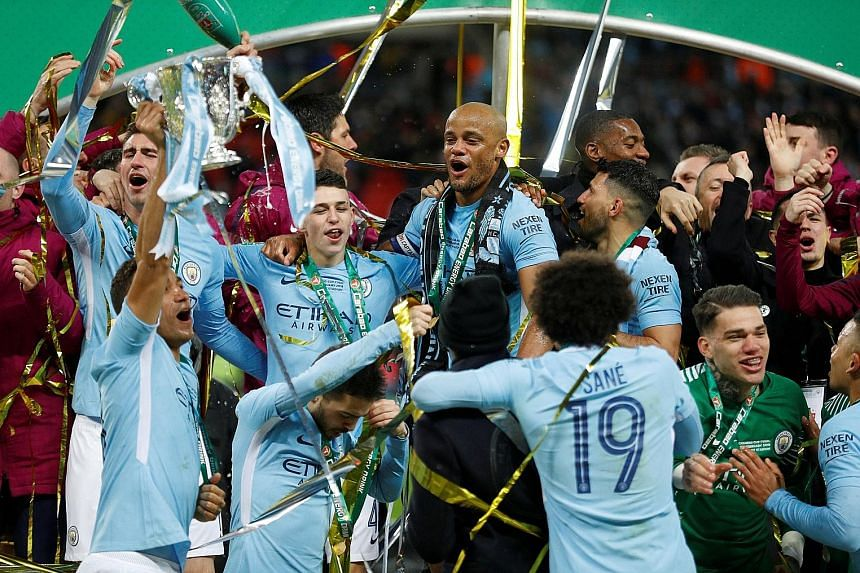 Manchester City captain Vincent Kompany, named Man of the Match, celebrating the League Cup win on Sunday with his team-mates.