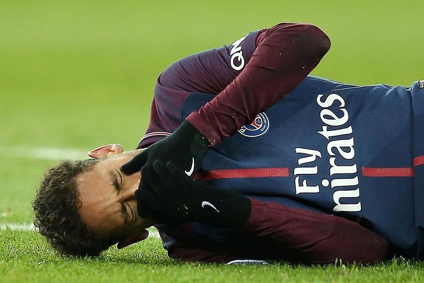 Paris Saint-Germain striker Neymar in distress after injuring his ankle during the 3-0 win over Marseille in Ligue 1 on Sunday. PSG coach Unai Emery is confident that the Brazilian will be fit for the Champions League last-16 return leg against Real