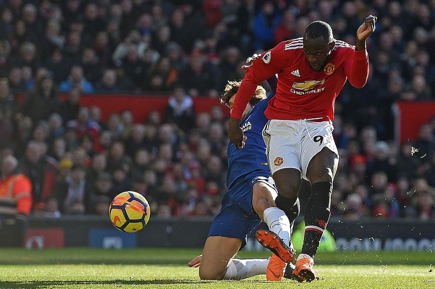 Romelu Lukaku holding off the challenge of Marcos Alonso while scoring Manchester United's equaliser against Chelsea. His assist for Jesse Lingard's winner on Sunday kept Chelsea outside the league's top four.