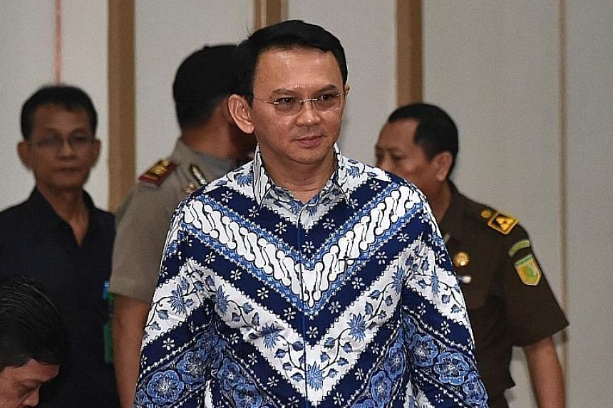 """Basuki, better known as Ahok, was found guilty of insulting Islam by a Jakarta district court on May 9 last year and sentenced to two years in jail. Supporters of Basuki Tjahaja Purnama with a placard message that translates to """"Freedom for Ahok"""" out"""