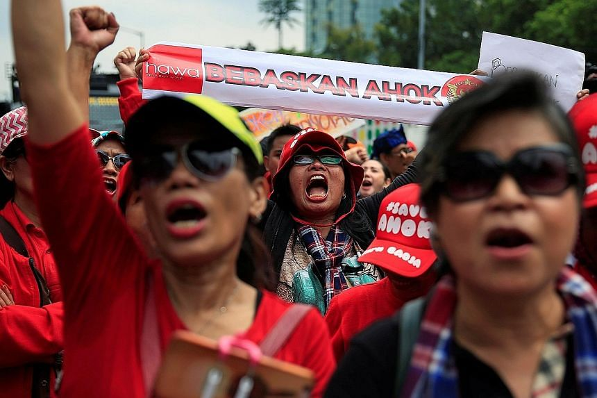 "Basuki, better known as Ahok, was found guilty of insulting Islam by a Jakarta district court on May 9 last year and sentenced to two years in jail. Supporters of Basuki Tjahaja Purnama with a placard message that translates to ""Freedom for Ahok"" out"