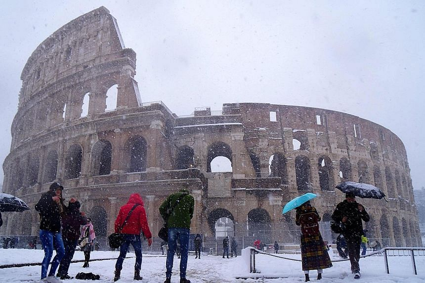 """Rome woke to its first snowfall in six years yesterday as chilling winds from Siberia swept across Europe, bringing freezing temperatures that have claimed at least four lives, closed schools and disrupted travel. The """"Beast from the East"""", as the ph"""