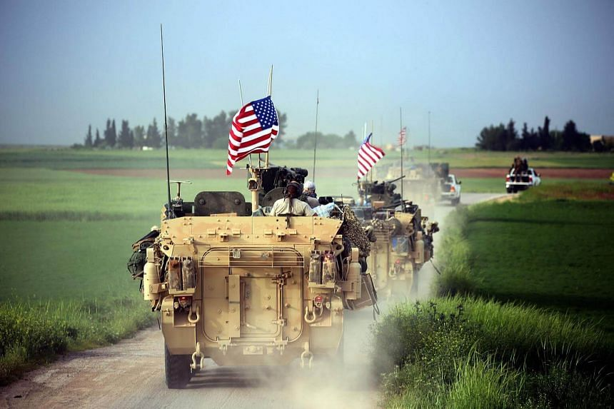 File photo showing US forces driving armoured vehicles near the northern Syrian village of Darbasiyah on April 28, 2017.