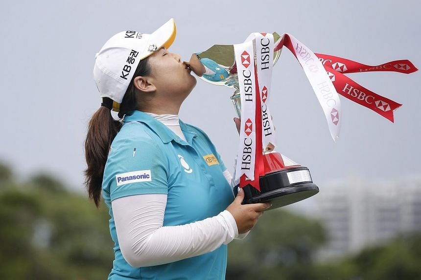 South Korea's Park In Bee kissing the trophy after winning the HSBC Women's Champions at the Tanjong Course in Sentosa on March 5, 2017.