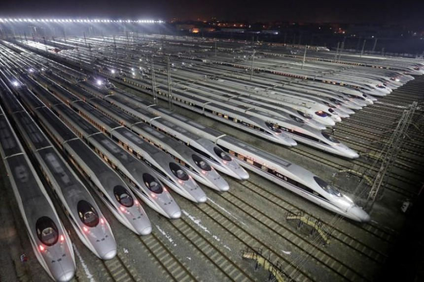 China Railway High-speed Harmony bullet trains at a high-speed train maintenance base in Wuhan, Hubei province, China on Feb 1, 2018.