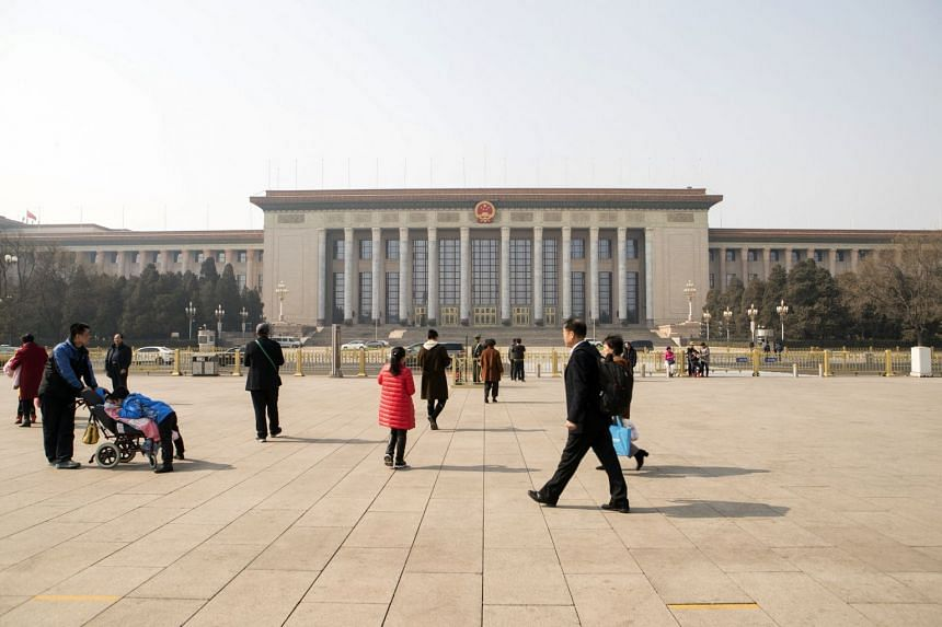 People walking outside the Great Hall of the People in Beijing, China, on Feb 26, 2018.