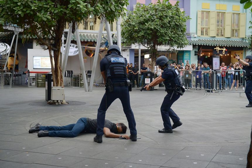 Police conducting an anti-terrorism exercise at Clarke Quay on Nov 10, 2017. The proposed Public Order and Safety (Special Powers) Bill empowers the police to make a communications stop order.