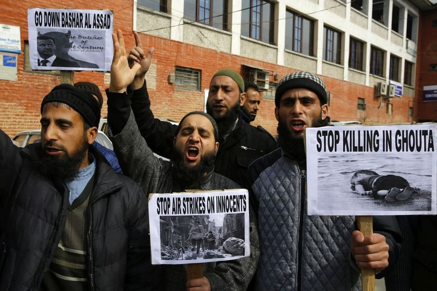 Members of the Global Islamic Research Forum shout slogans and hold placards during a protest in Srinagar, India, on Feb 27, 2018.