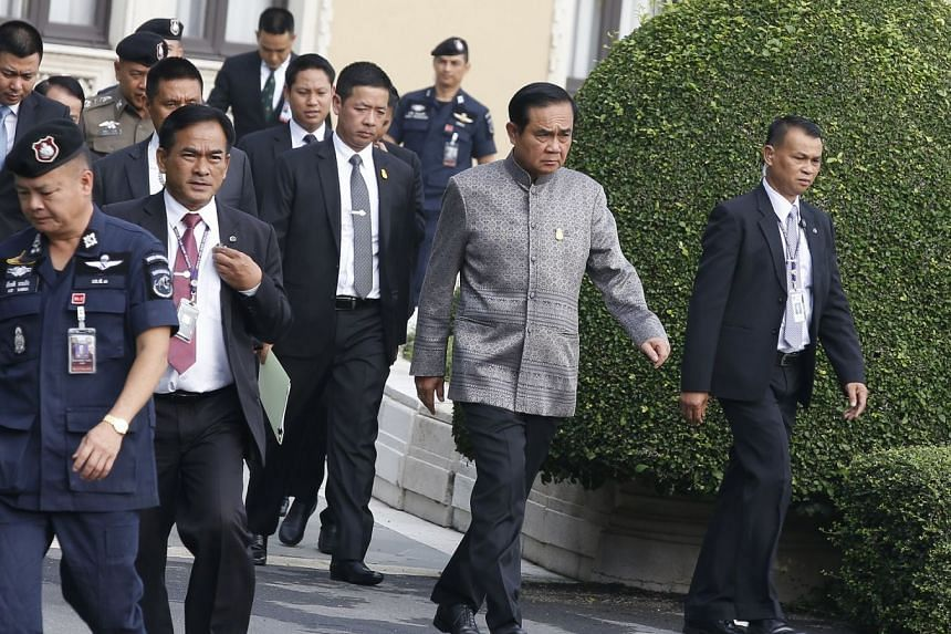 Thai Prime Minister Prayut Chan-o-cha (second from right) arrives for a weekly cabinet meeting at the Government House in Bangkok, on Feb 27, 2018.