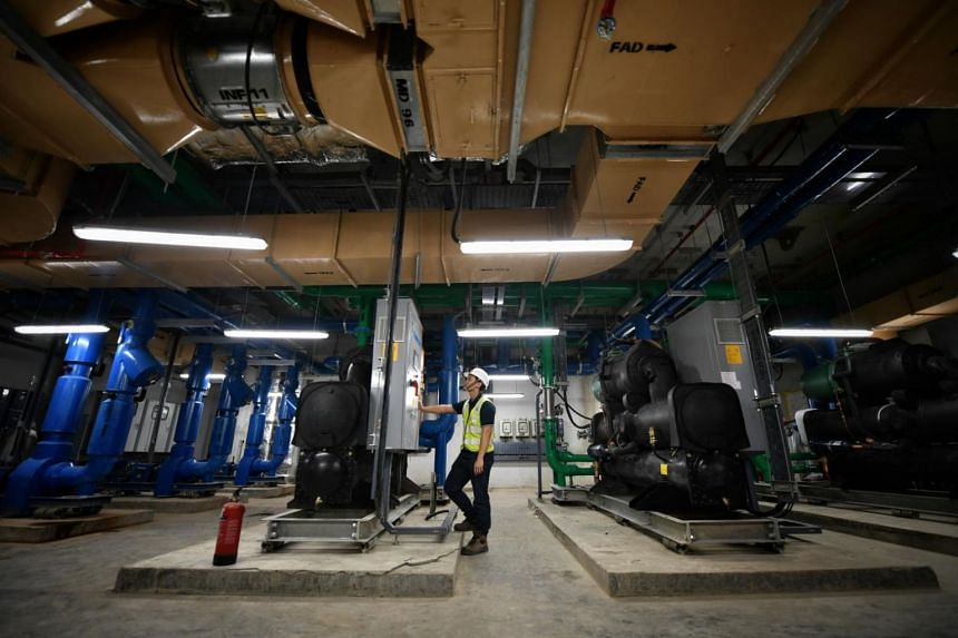An engineer checking equipment that controls air-conditioning and tunnel ventilation at the Tampines West station on Sept 22, 2017.