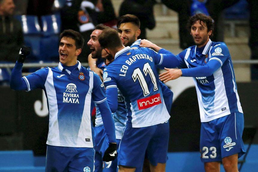 Espanyol's Gerard Moreno (left) celebrates with team mates.