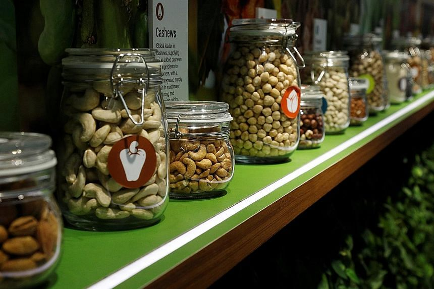 Jars of Olam's products, such as almonds, cashews and peanuts, displayed at its office in Singapore last year. The company is using sensors in its almond plantations in California and Australia to improve water-use efficiencies.
