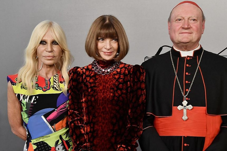 (From left) Italian designer Donatella Versace, Vogue editor-in-chief Anna Wintour and Cardinal Gianfranco Ravasi at the Palazzo Colonna for the preview of the exhibition, Heavenly Bodies: Fashion And The Catholic Imagination.