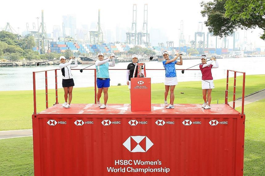From left: Tiffany Chan, Feng Shanshan, defending champion Park In Bee, Lexi Thompson and Ryu So Yeon posing atop a shipping container at the Sentosa Golf Club during the launch of the HSBC Women's World Championship yesterday. The first round starts