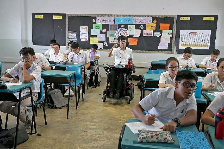 Mr Wong Zi Heng, 26, teaching a class at Bedok South Secondary School during a four-month teaching stint last year. He is currently pursuing a postgraduate diploma in education at the National Institute of Education.