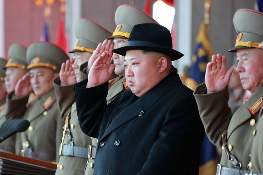 Kim Jong-Un (second right) attending a military parade to mark the 70th anniversary of the Korean People's Army.