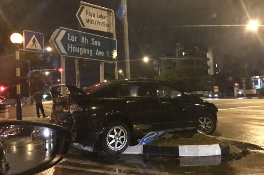 The accident left a black car stranded on a grass verge at the junction of Upper Paya Lebar Road and Lorong Ah Soo on Feb 28, 2018.
