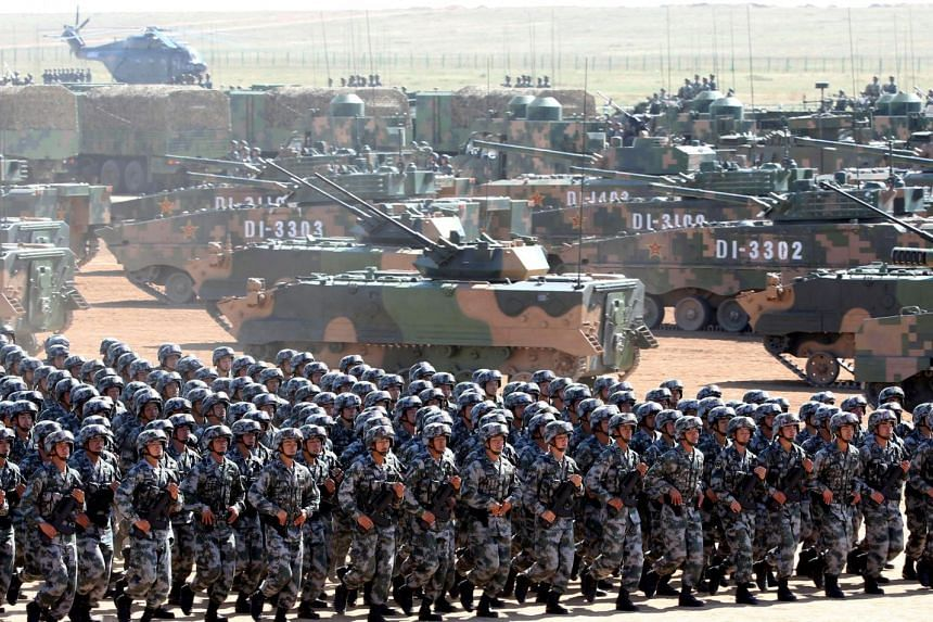 People's Liberation Army soldiers marching in a parade to commemorate the 90th anniversary of the army's founding. at the Zhurihe military training base in Inner Mongolia Autonomous Region, on July 30, 2017.