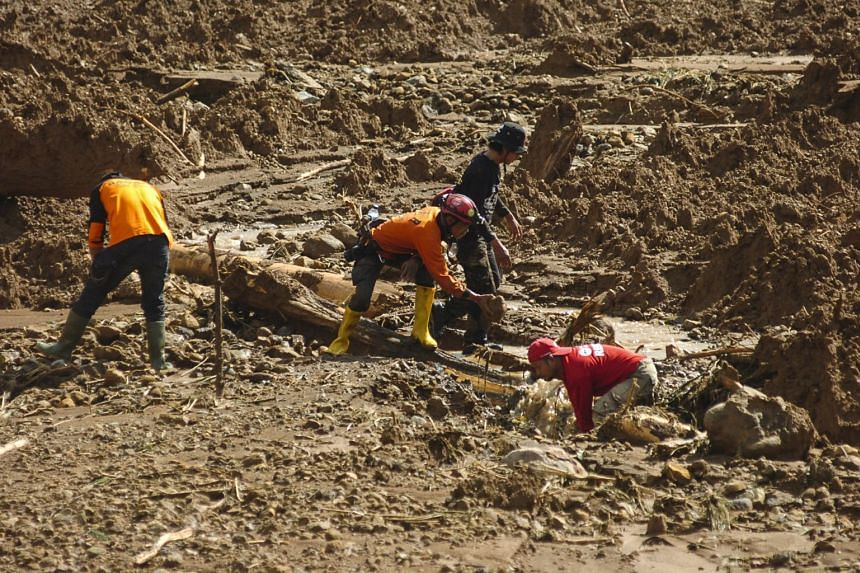Rescuers searching for victims at the site of a landslide in Brebes, central Java, in Indonesia, on Feb 23, 2018.