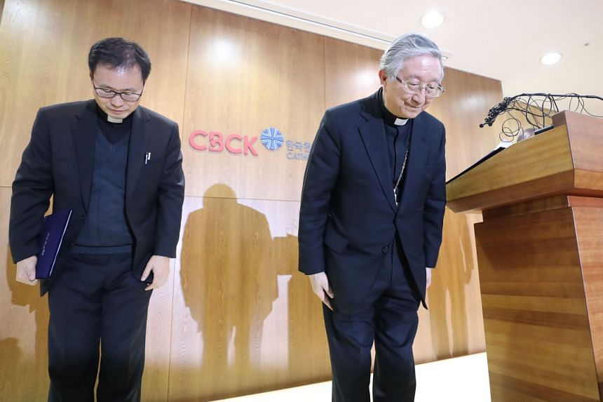 Archbishop Hyginus Kim Hee-joong (right), president of the Catholic Bishops' Conference of Korea (CBCK), bowing in apology over a sex abuse scandal by a priest, in Seoul on Feb 28, 2018.