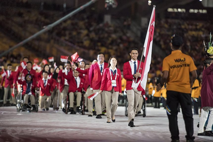 Team Singapore athletes at the Asean Para Games in Kuala Lumpur on Sept 17, 2017. President Halimah Yacob hosted a reception at the Istana to congratulate Singapore athletes for their performances last year, on Feb 28, 2018.