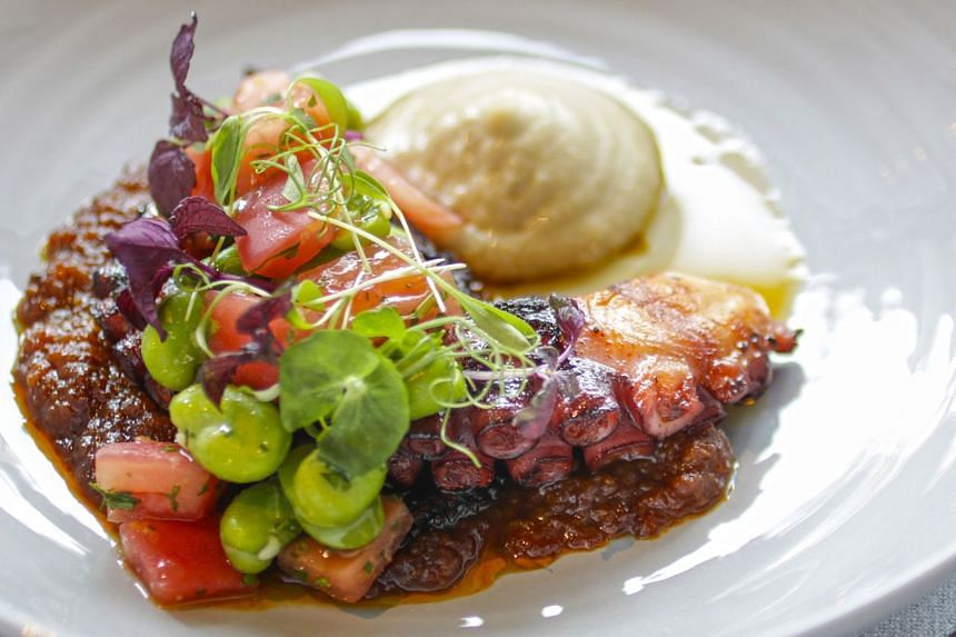 The charred octopus with tomato jam, egg plant puree and fava beans.