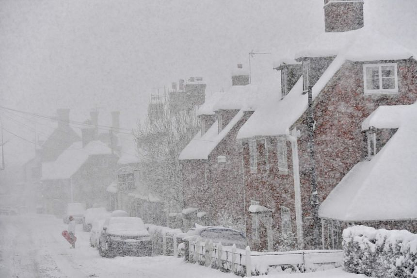 A man stands in the falling snow in the village of Brenchley in south-east England, on Feb 27, 2018. PHOTO: AFP