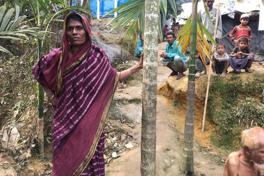Bangladeshi farmer Jorina Katun stands among the Rohingya Muslims camped out on her land near the Kutapalong refugee camp in the Cox's Bazar district of Bangladesh on Feb 9, 2018.