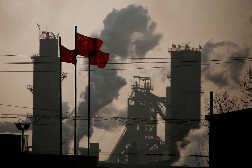 National flags flying near a steel factory in China's Hebei province on Feb 23, 2017.