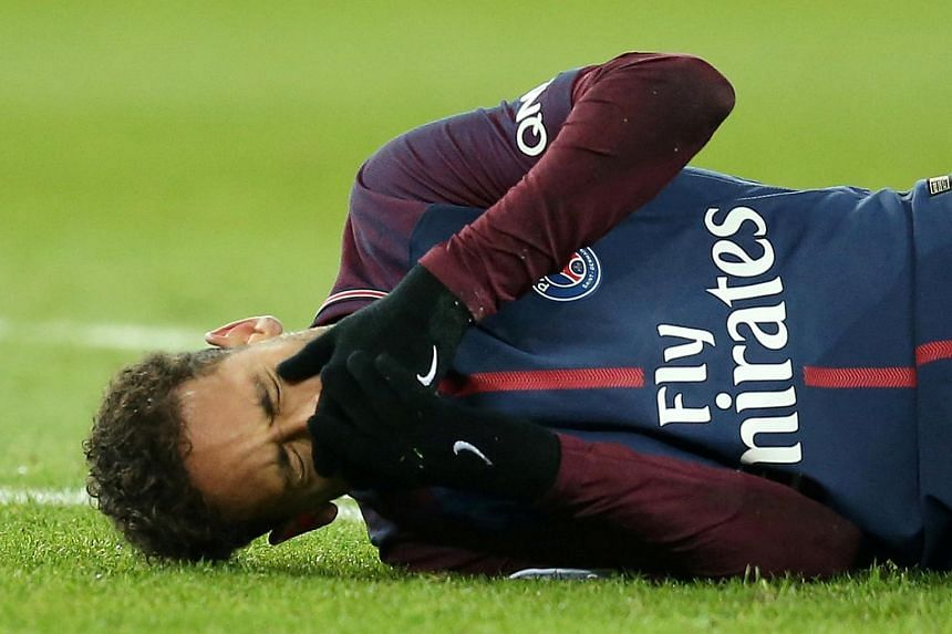 Paris Saint-Germain's Neymar was in tears as he was carried off the pitch during the match against arch-rivals Olympique de Marseille.