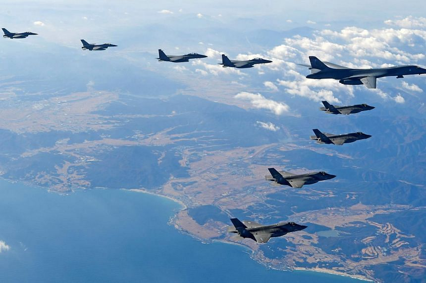 A US Air Force B-1B bomber flies in formation during a joint aerial drill called 'Vigilant Ace' between US and South Korea, on Dec 6, 2017.