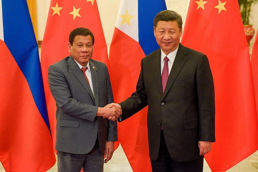 Chinese President Xi Jinping (right) shakes hands with Philippines President Rodrigo Duterte prior to their bilateral meeting at the Belt and Road Forum in Beijing, China, on May 15, 2017.
