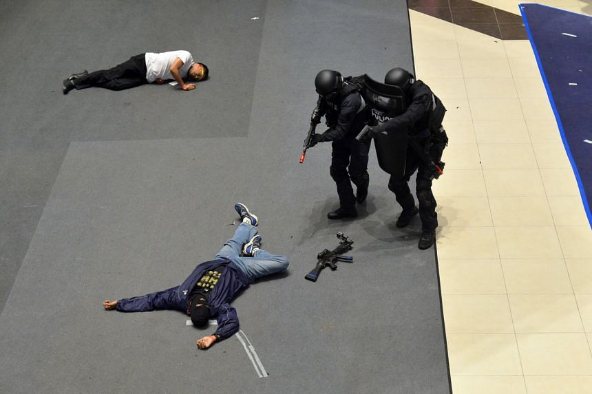 Officers from the police's Emergency Response Team (ERT) during a counter-terrorism readiness exercise at Tampines Central Mall on Oct 17, 2016.