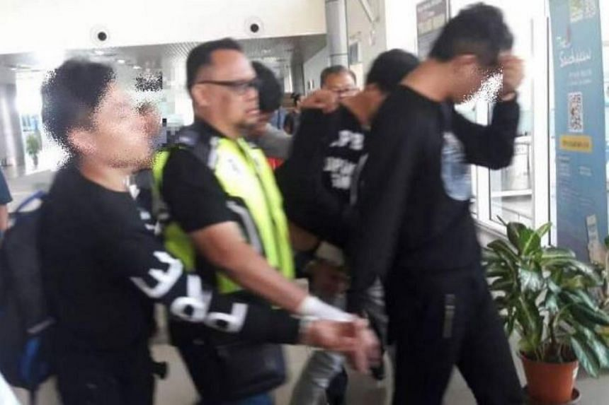 The video shows Malaysian customs officers and airport policemen nabbing one of the suspects who was trying to flee from the arrival hall in the incident on Feb 27, 2018.