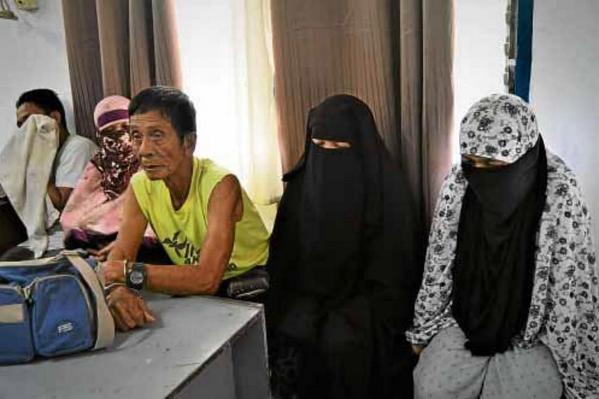 The five terror suspects, who were arrested on Feb 25, inside the police headquarters in Cagayan de Oro City, Philippines.