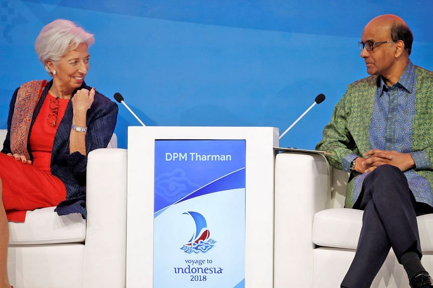 """Ms Christine Lagarde with Mr Tharman Shanmugaratnam at the conference yesterday. He cited fintech as the latest wave in financial innovation which he said took many by surprise, but """"we are now riding on this wave""""."""