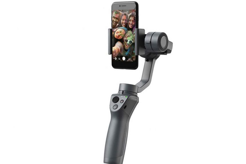 The DJI Osmo Mobile 2's new spring-loaded clamp lets you slot in smartphones of any size easily.
