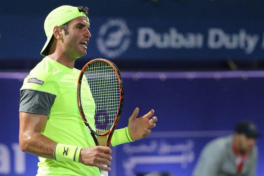 Jaziri reacts during his match against Grigor Dimitrov.