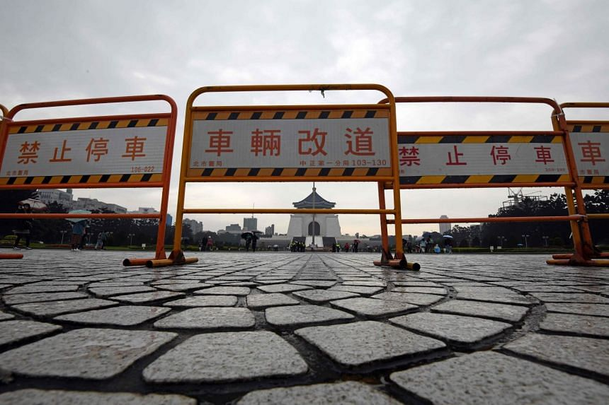 Barricades are seen placed at entrance of the Chiang Kai-shek Memorial Hall in Taipei on Feb 28, 2018.