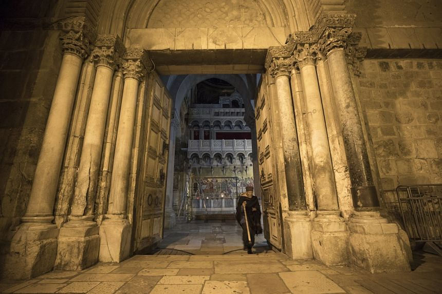A devotee visits the Church of the HolySepulchre in Jerusalem's old city as it reopens on Feb 28, 2018.
