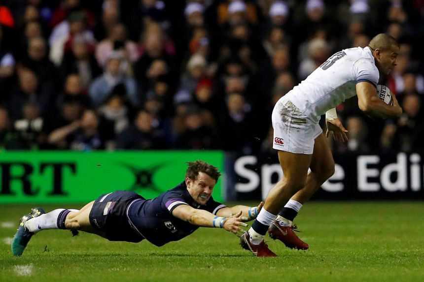 England's Jonathan Joseph in action with Scotland's Peter Horne on Feb 24, 2018.