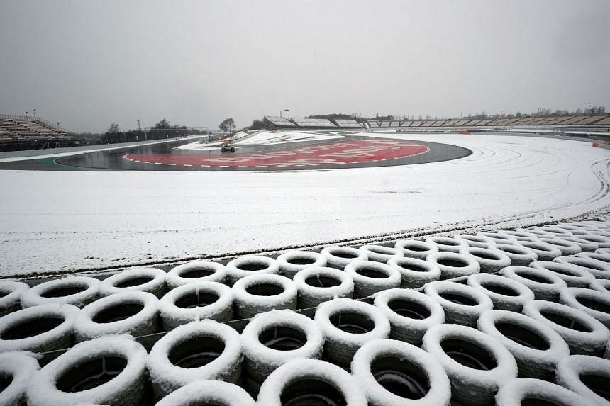 Race control checks the track surrounded by snow before testing.