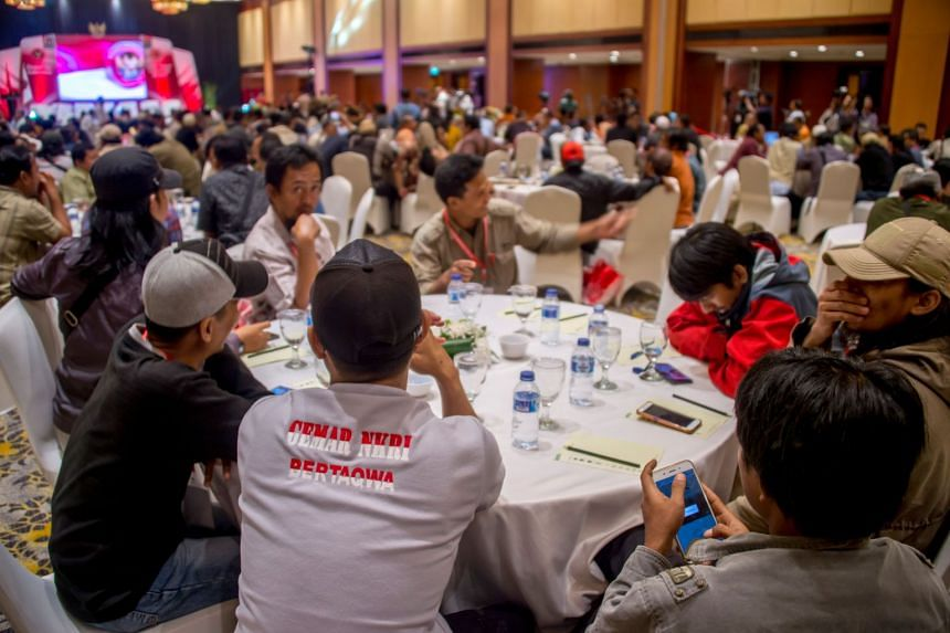 "Government officials, former militants and terror attack survivors attending a ""terrorist-victim"" meeting in Jakarta on Feb 28, 2018."