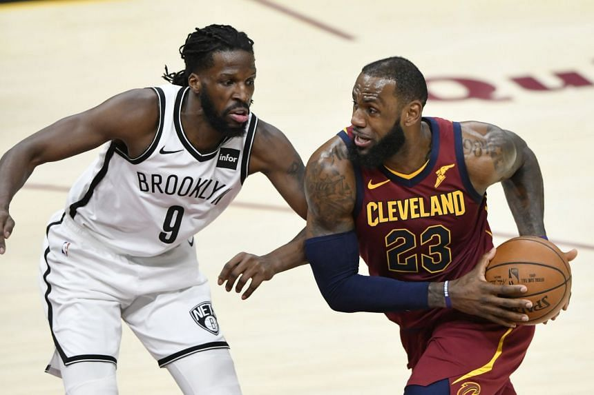 Cleveland Cavaliers forward LeBron James drives against Brooklyn Nets forward DeMarre Carroll in the third quarter at Quicken Loans Arena on Feb 27, 2018.