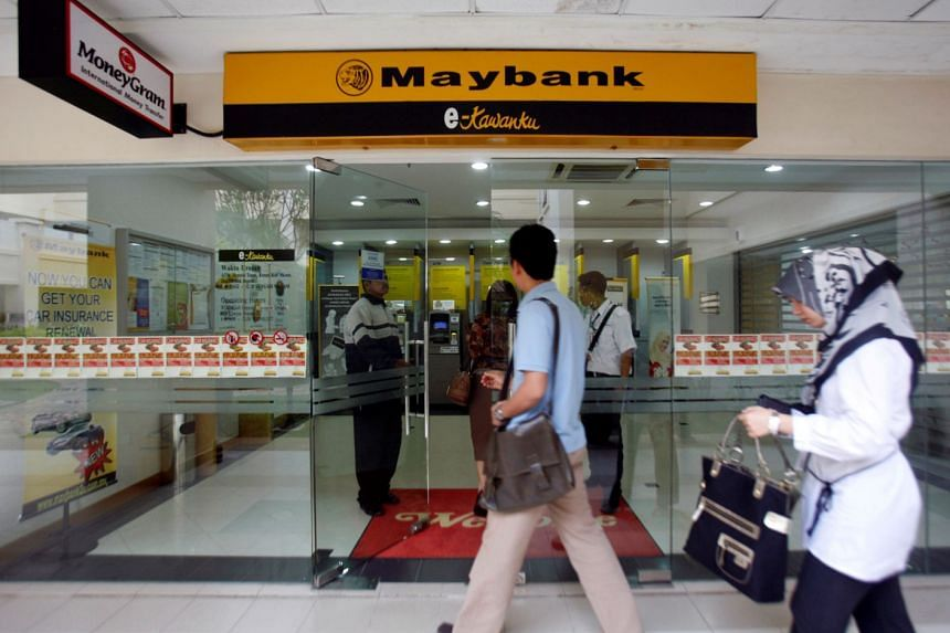 Maybank recorded an 11 per cent decline in fourth-quarter net profit, despite a slight rise in net interest income.
